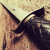 Antique sword. On wooden background Royalty Free Stock Photo