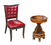Antique table and chair. Antique leather chair and round wooden table isolated on white background stock image