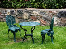 Antique Table And Chairs With Stone Wall Stock Photo