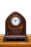 Antique Table Clock. On a Wooden Shelf in front of a White Wall Stock Photography