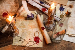 Antique table filled with old papers, red sealant Royalty Free Stock Image