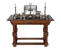 Antique table for serving with silverware Royalty Free Stock Photo