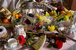 Antique tableware and food on table Stock Image