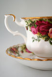 Antique Tea Cup. The beautiful details of an antique tea cup can be seen in this photograph Royalty Free Stock Photography