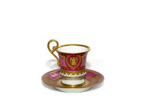 Antique tea cup & saucer. An old antique tea cup and a saucer isolated on white Royalty Free Stock Image