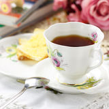 Antique tea cup on the table Royalty Free Stock Photo