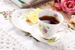 Antique tea cup on the table Stock Photos