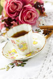 Antique tea cup on the table Stock Images