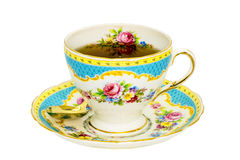 Antique tea cup with tea. Stock Photos