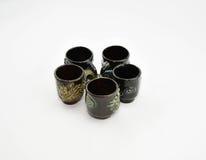 Antique tea cups. Antique tea cup five piece Royalty Free Stock Photo