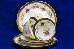 Antique tea cups set for two on blue background. Stock Photography