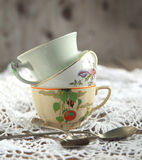 Antique tea cups and spoons Royalty Free Stock Image