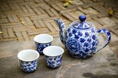Antique tea set. Antique china tea set on old wood table Stock Photo