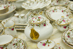 Antique tea set with floral print Stock Image