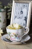 Antique Teacup with Old Photograph Stock Photo