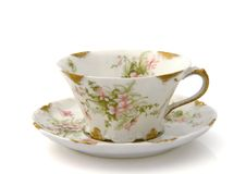 Antique Teacup and Saucer. With a floral pattern isolated on white Stock Photos
