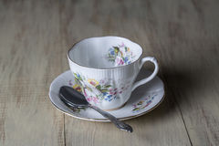 Antique Teacup with Silver Spoon Stock Photography