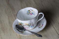 Antique Teacup and spoon on Wood Background Stock Images