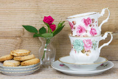 Antique teacups and cookies Stock Photos