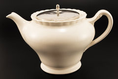 Antique teapot on a black background.  Stock Photography