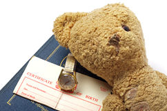 Antique teddy bear and old watch Stock Images