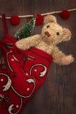 Antique teddy bear in stocking