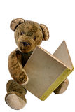 Antique Teddy reading in an old book Stock Images