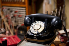 Antique telephone. Antique black telephone with numbers to dial Stock Images