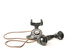 Antique Telephone. An antique telephone with handset off the hook Stock Photography