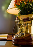 Antique Telephone. On a work desk Royalty Free Stock Photo
