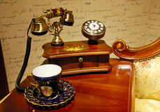 Antique telephone. A antique telephone on the Antique table Royalty Free Stock Photography