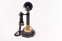 Antique telephone. Antique black telephone isolated on white background Stock Image