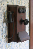 Antique Telephone. Hanging on a wall Stock Photography
