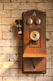 Antique telephone on brick wall. Antique telephone on brick wall with art lighting effect Royalty Free Stock Image