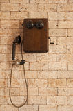 Antique telephone on brick wall. Antique telephone on brick wall retro style Stock Images