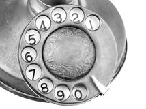 Antique Telephone. Antique candlestick telephone dialer in black and white stock photography