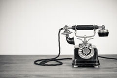 Antique telephone. Closeup of antique telephone with white background and copy space Royalty Free Stock Photo