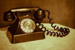 Antique telephone. On the desk Royalty Free Stock Photography