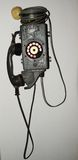 Antique telephone. An  antique telephone made of iron placed on the wall Royalty Free Stock Images