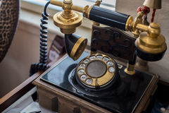 Antique telephone. Old antique telephone on transmitter Royalty Free Stock Photo