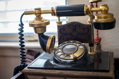 Antique telephone. Old antique telephone on transmitter Stock Photography