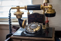 Antique telephone. Old antique telephone on transmitter Stock Images