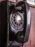 Antique telephone. Rotary phone dial, antique telephone on wall Royalty Free Stock Image
