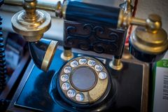 Antique telephone on the table. Antique vintage telephone on the table Stock Image