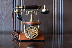 Antique telephone on the table. Antique vintage telephone on the table Stock Photography