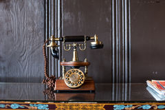 Antique telephone on the table. Antique vintage telephone on the table Royalty Free Stock Photography