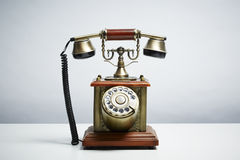 Antique telephone on white background Royalty Free Stock Photography