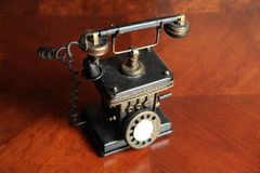 Antique telephone. On a wooden table Stock Photo