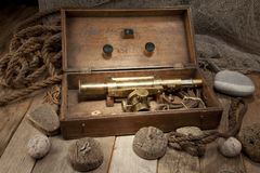 Antique telescope. In wooden box Royalty Free Stock Image