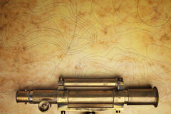 Antique telescope. With sea map Stock Photography
